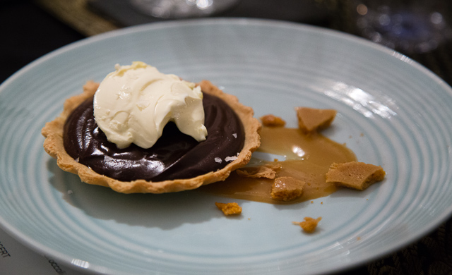 Chocolate tart with salted caramel sauce honeycomb and clotted cream. Photo from London Unattached.